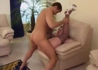 Blonde with big tits likes doggy style sex