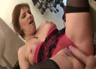 Busty auntie jumps on cock like pro