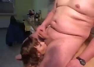 Daddy drills a busty daughter in the kitchen