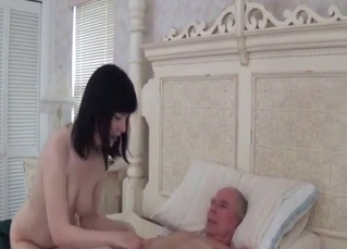 Old man is getting stimulated by daughter