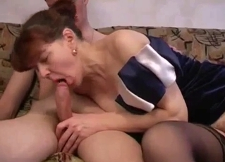 Redhead mom pleases her son in a dirty way