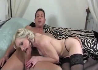 Busty auntie stimulates my dick with love