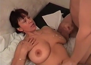 Son cums a huge load on big tits of his mom