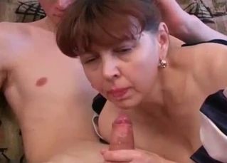 Mom is sucking son's dick with passion
