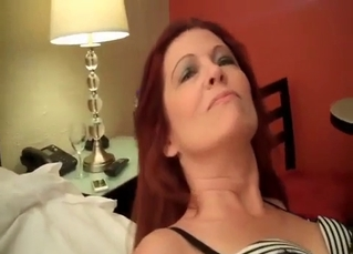 Redhead mom with big ass looks so sexy