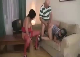 Two sisters are sucking their daddy with passion