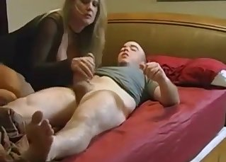 Busty mommy plays with son's hard dick