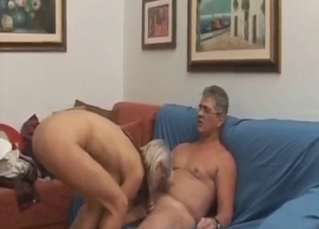 Awesome blonde rides her horny daddy