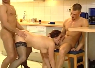 Redhead mom gets fucked by two horny men