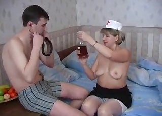 Passionate mom is sucking a skinny stud