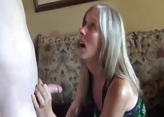 Blonde mom gives a blowjob for her son