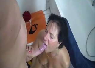 Big-tit mom sucks her young son with love