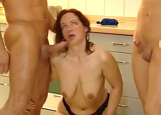 Filthy mom with big tits sucks two men