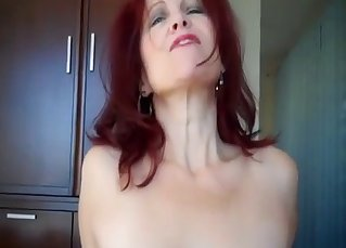 Redhead mommy jumps on her dirty son
