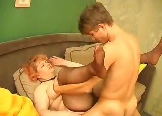 Curly mom is sucking her son with love