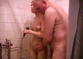 Daughter is washing her daddy's hard prick